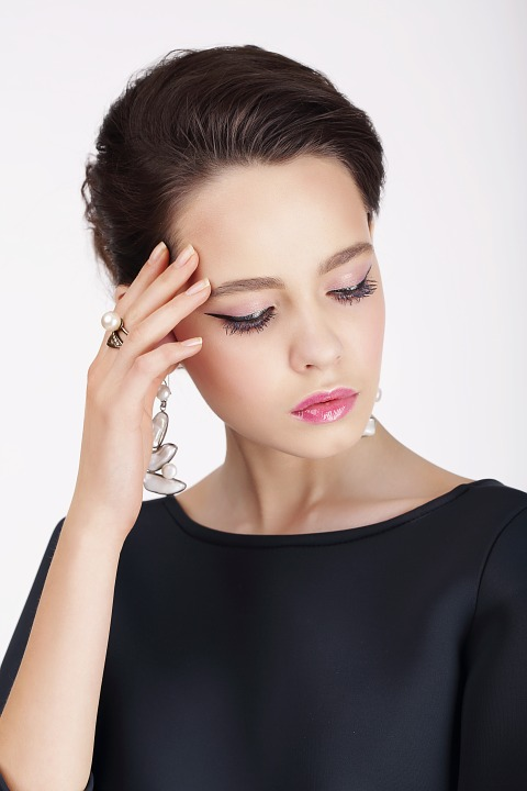 Woman Livening up eyes with shimmering eye makeup
