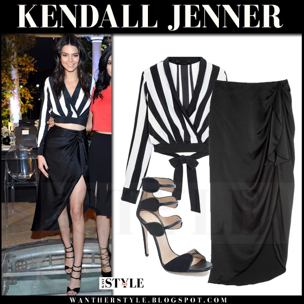 Kendall Jenner in black white striped crop top and black midi skirt what she wore kendall + kylie collection 2016