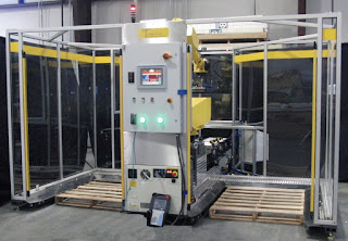 Dual cell palletizer with track and trace allows robot to continue palletizing while full pallet is removed.