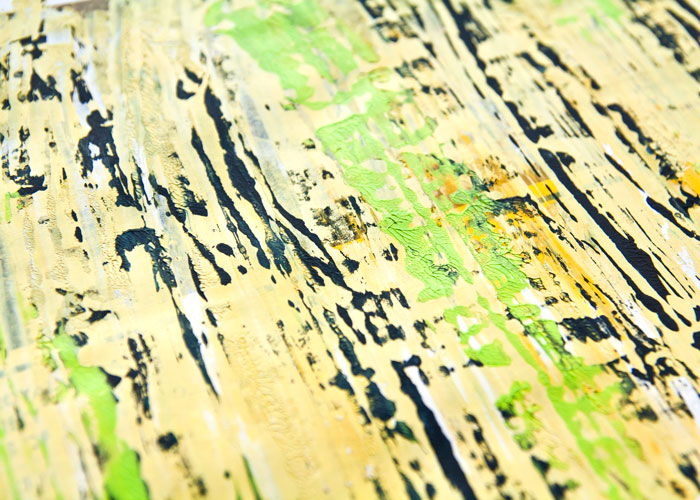 Close up of acrylic paint page pressing texture on one of the pages shared in the video by Kim Dellow