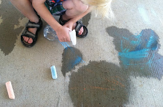 Spraying Water on Chalk Drawing (Brick by Brick)