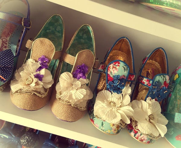 faded image showing archive Irregular Choice shoes on white shelf