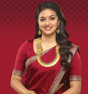 Keerthy Suresh in Red Saree with Cute and Awesome Lovely Smile for AVR Jewellery Ad Images