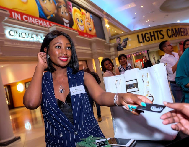 Tsogo Sun Rewards - Phuti Khomo having fun with her Tsogo Sun rewards card