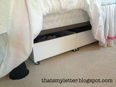 bedskirt hides storage and bed risers