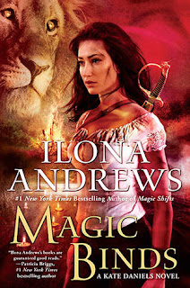 Cover description: Kate stands against a red, fiery background with a lion just behind her.