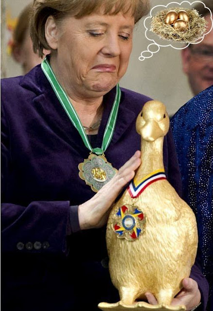 Merkel impressed by a golden duck