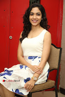 Actress Ritu Varma Stills in White Floral Short Dress at Kesava Movie Success Meet .COM 0230.JPG