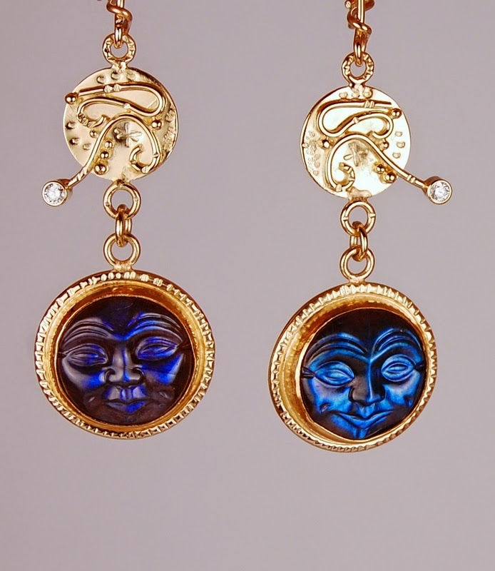 carved blue stone moon faces with a disc above them with wires, beads and diamonds