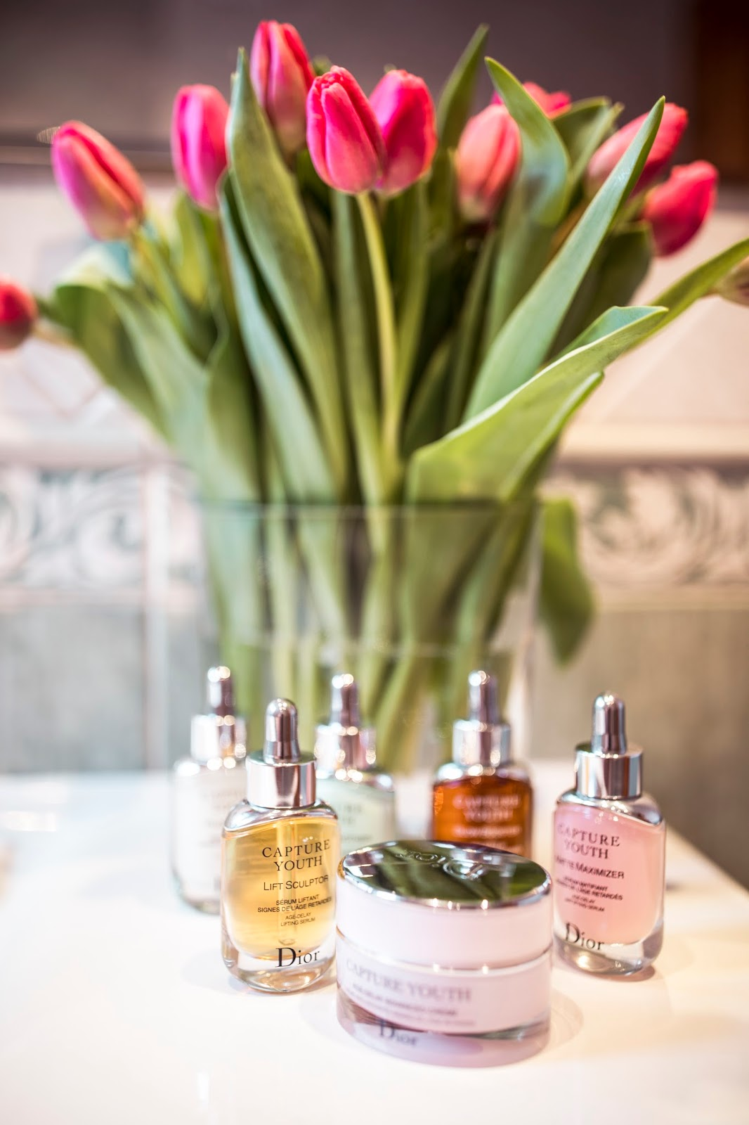 dior capture yout beauty skincare products pink flowers bathroom