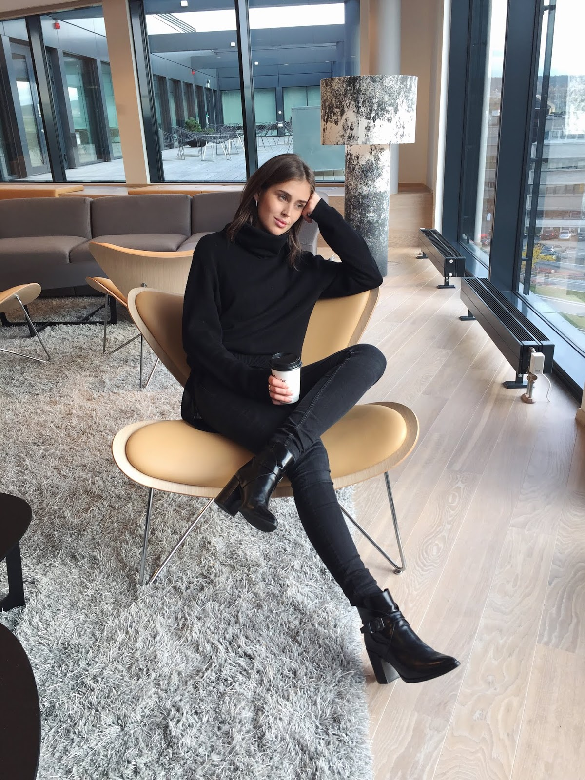 The All-Black Uniform I'll Be Wearing All Fall and Winter — Darja Barannik Instagram Outfit Idea With Black Turtleneck Sweater, Black Skinny Jeans, and Black Ankle Boots