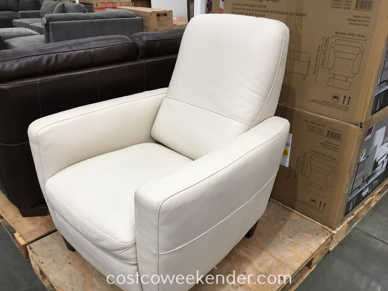 Kick back and relax in your home on the Natuzzi Group Leather Push-back Recliner