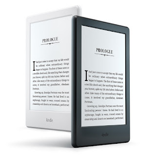 photo of two amazon kindles. one is white and the other is black.