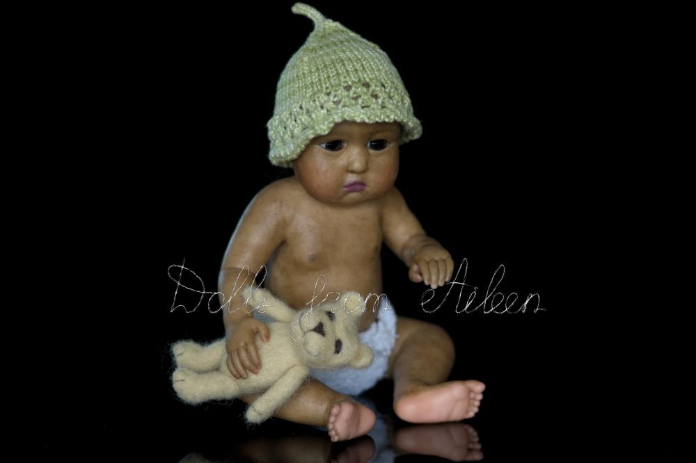 OOAK baby girl doll holding her teddy bear