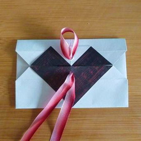 Ribbon fastening in a handmade diy envelope design craft