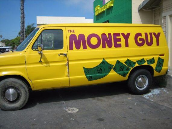 "Yellow van says ""The Money Guy"" on side with drawings of dollar bills."