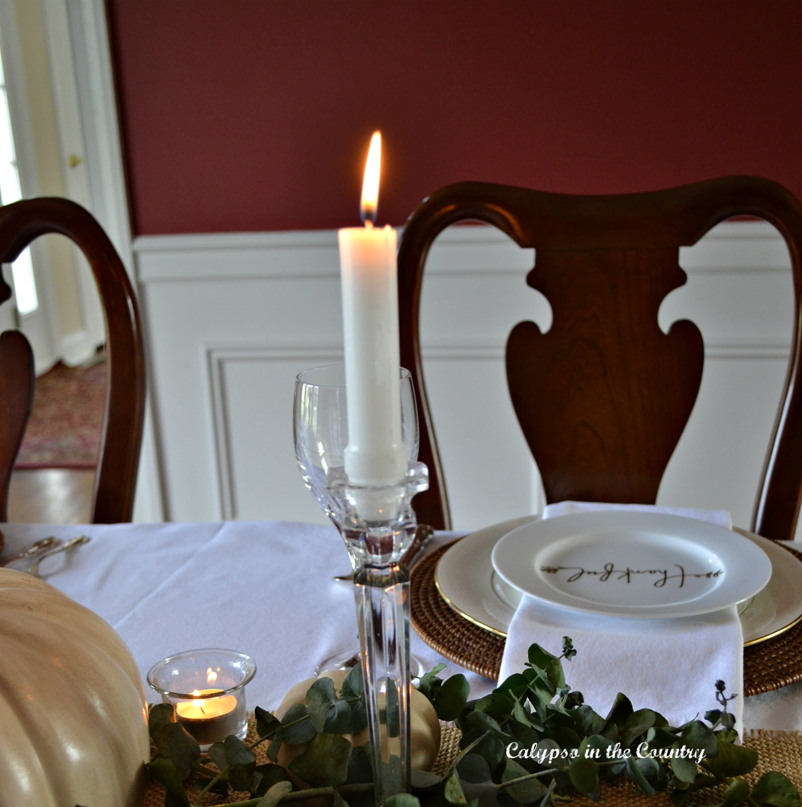 Red dining room and candle