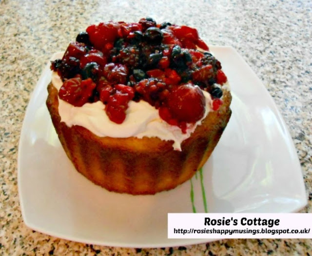 Giant Cupcake - Gently spoon on first your whipped cream and then your mixed berries