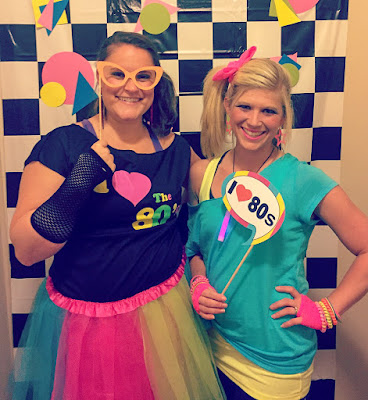 80's theme 30th birthday costume party. 80's style DIY outfit ideas. 80's photo booth backdrop and props.