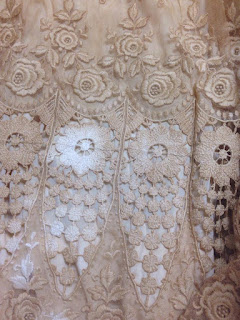 Detailed view of wedding dress lace pattern