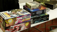 Boxes of board games on a table