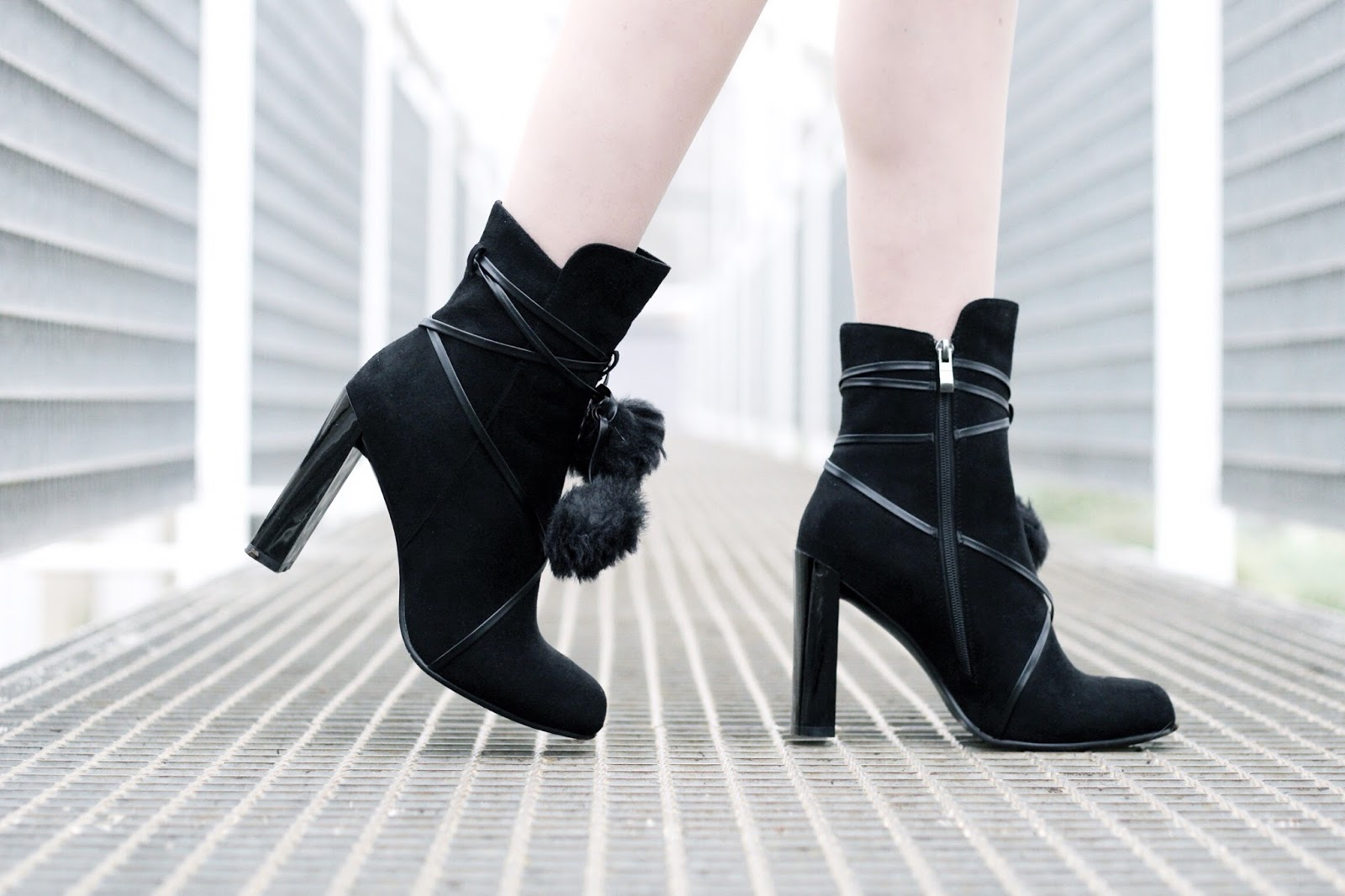 Black suede ankle boots by Lost Ink