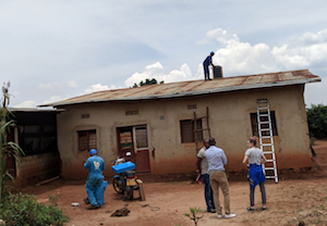 Installing on African roof (Image credit: BBOXX   Twitter) Click to Enlarge.