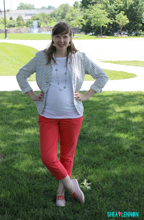 Spring or summer outfit idea - coral pants with a striped blazer, white tee, and floral sneakers.