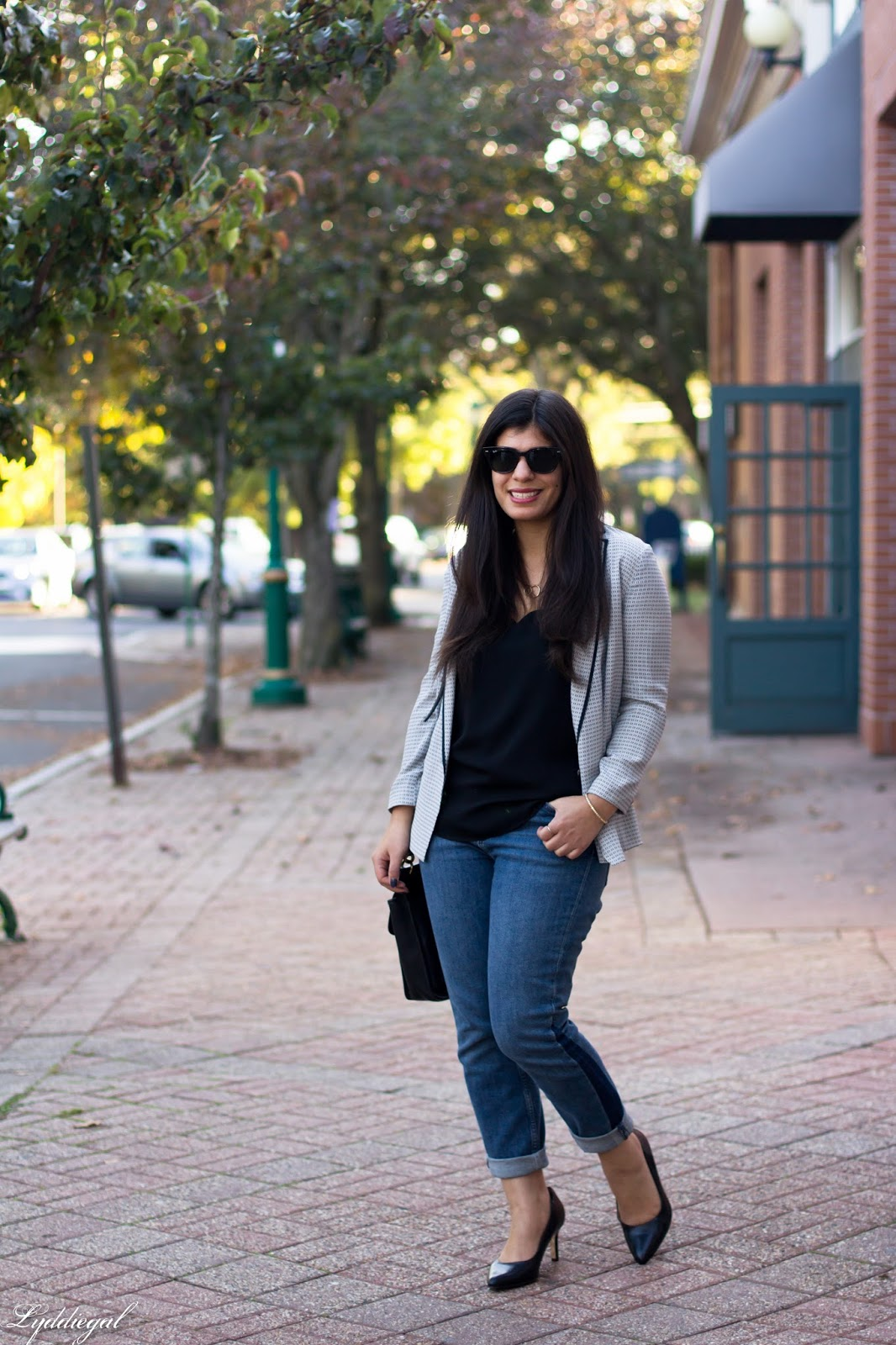 Easy fall work outfit for casual fridays with a silk blazer and cuffed jeans
