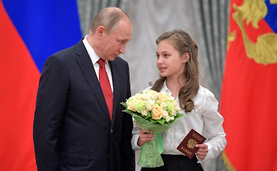 President Putin presents passports to young citizens of Russia.