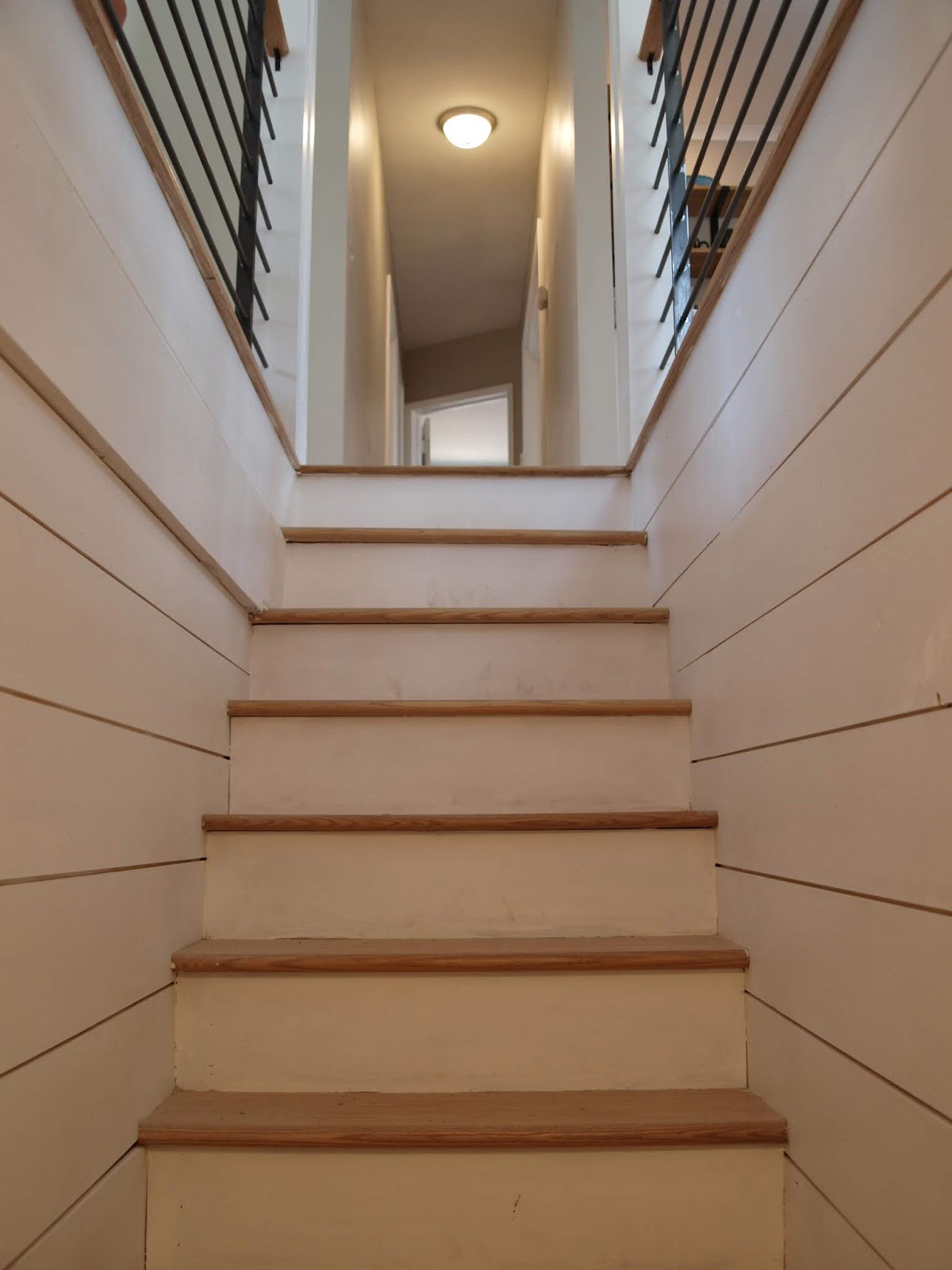 The Harvard Ranch Reveal Basement Stairs Design Staging Decor | Stairs Leading To Basement | Beautiful | Painted | Unfinished Basement | Metal | Basement Peaked Roof