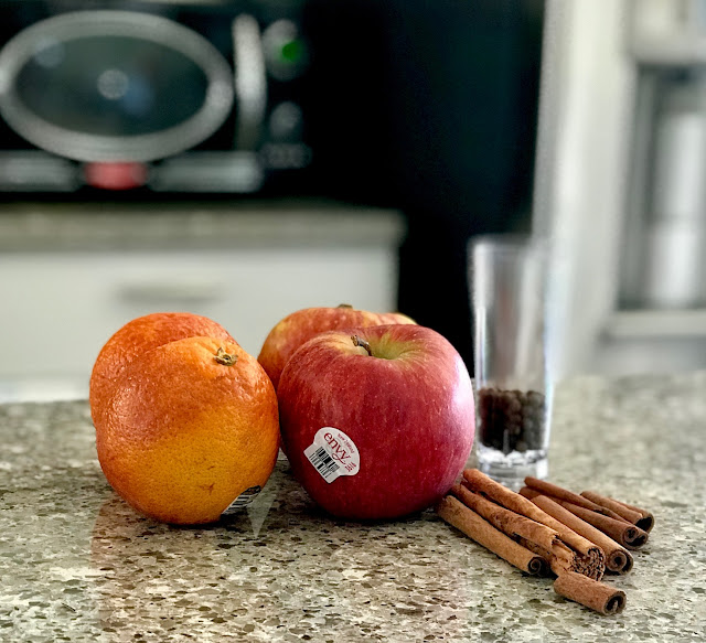 cinnamon sticks, allspice, apples, oranges