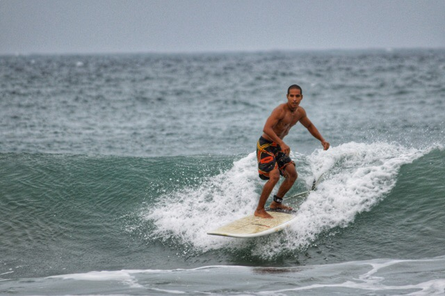Surfing at Okanda Beach