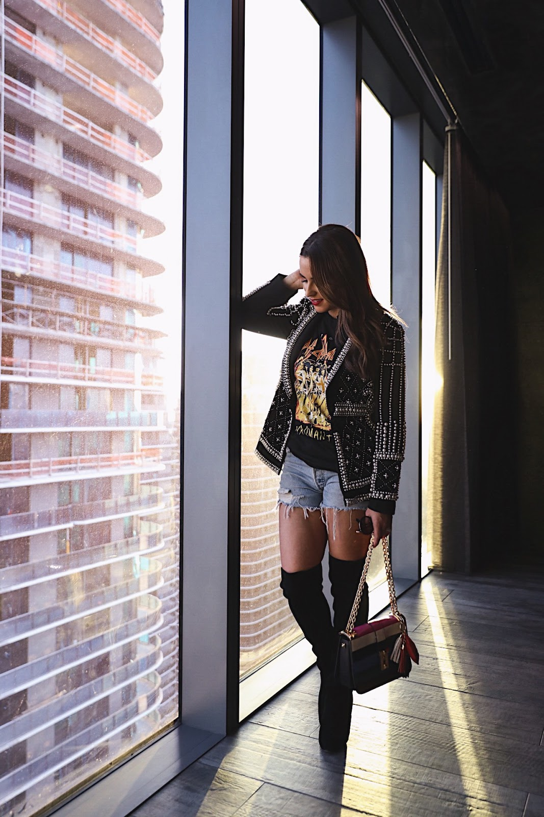 Fashion blogger Kelly Saks wears pearl blazer and marina over the knee boots. Street Style inspiration.