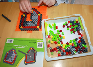 The Perler Dragon Slayer kit includes beads to make a shield, sword and dragon. Tessa started off by piecing together the shield.