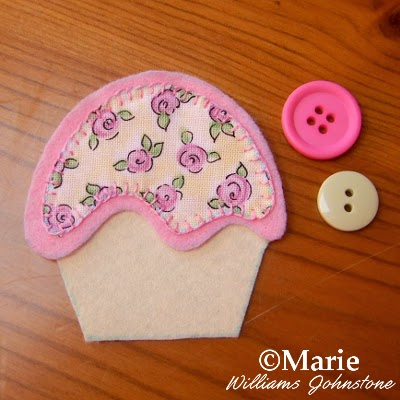 Pale pink and green button findings and a cup cake design in felt and fabric
