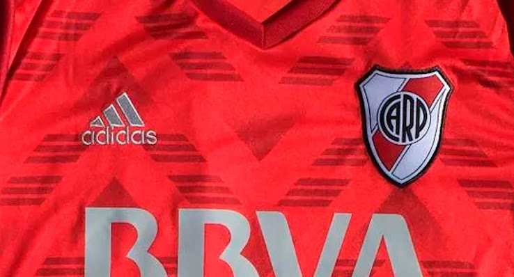 0ff23013a The v-collar of the River Plate 2017-2018 away jersey is dark red
