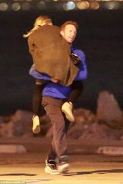 Chris Martin finally has a girlfriend, happily carries her in the street (photos)