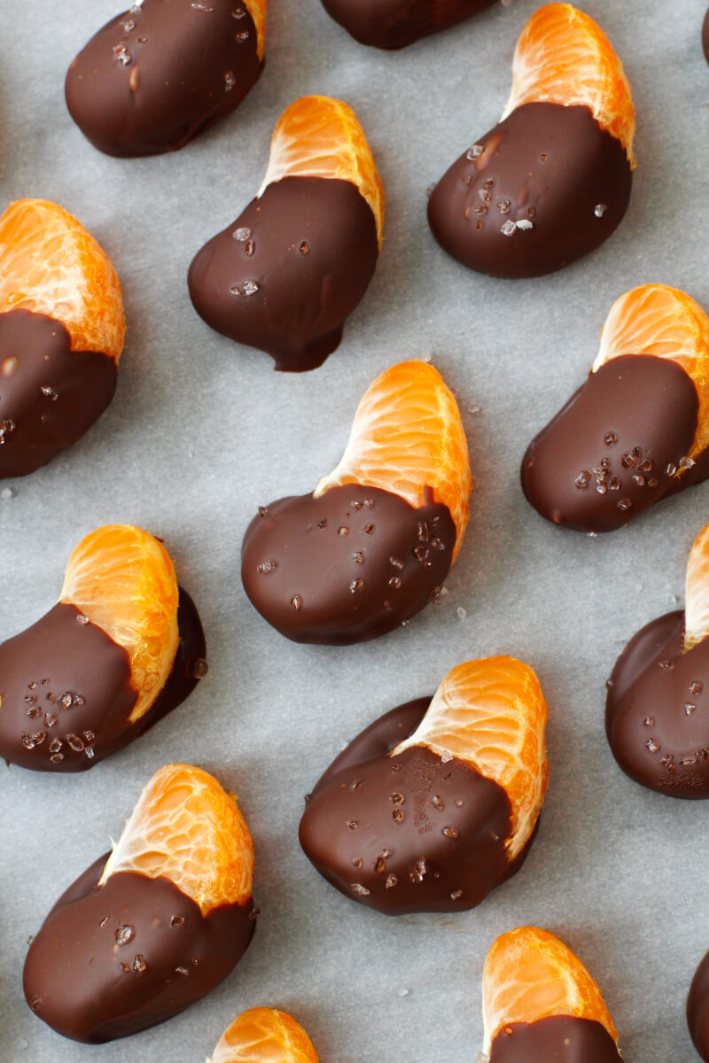 These 3-ingredient Chocolate Covered Oranges are so easy to make, you will want to eat them every day! With just a touch of sea salt sprinkled on top, they are sweet, salty, and absolutely irresistible! #chocolate #dessert #oranges #snack