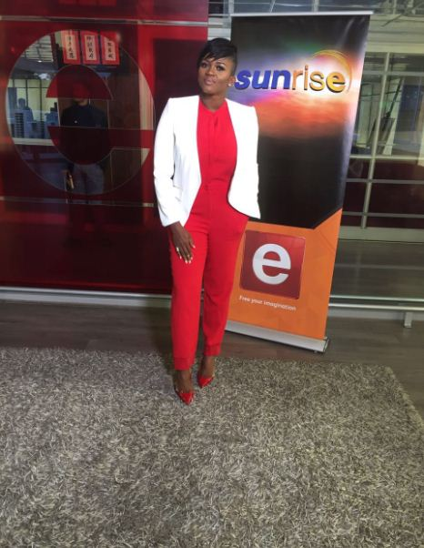 Waje in red suit