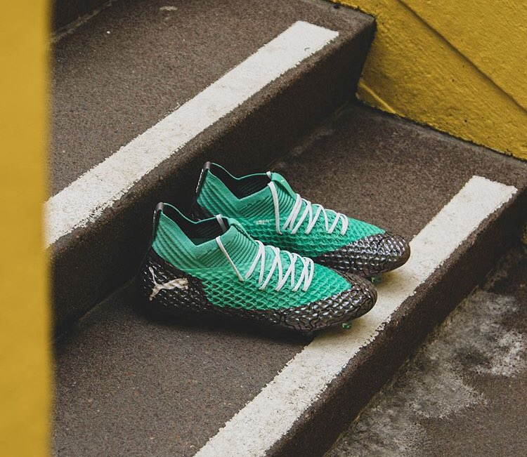 dd599125637858 Puma Future 2.1 Netfit - Silver   Turquoise. This image shows the Puma  Future Netfit 2018 World Cup boot.