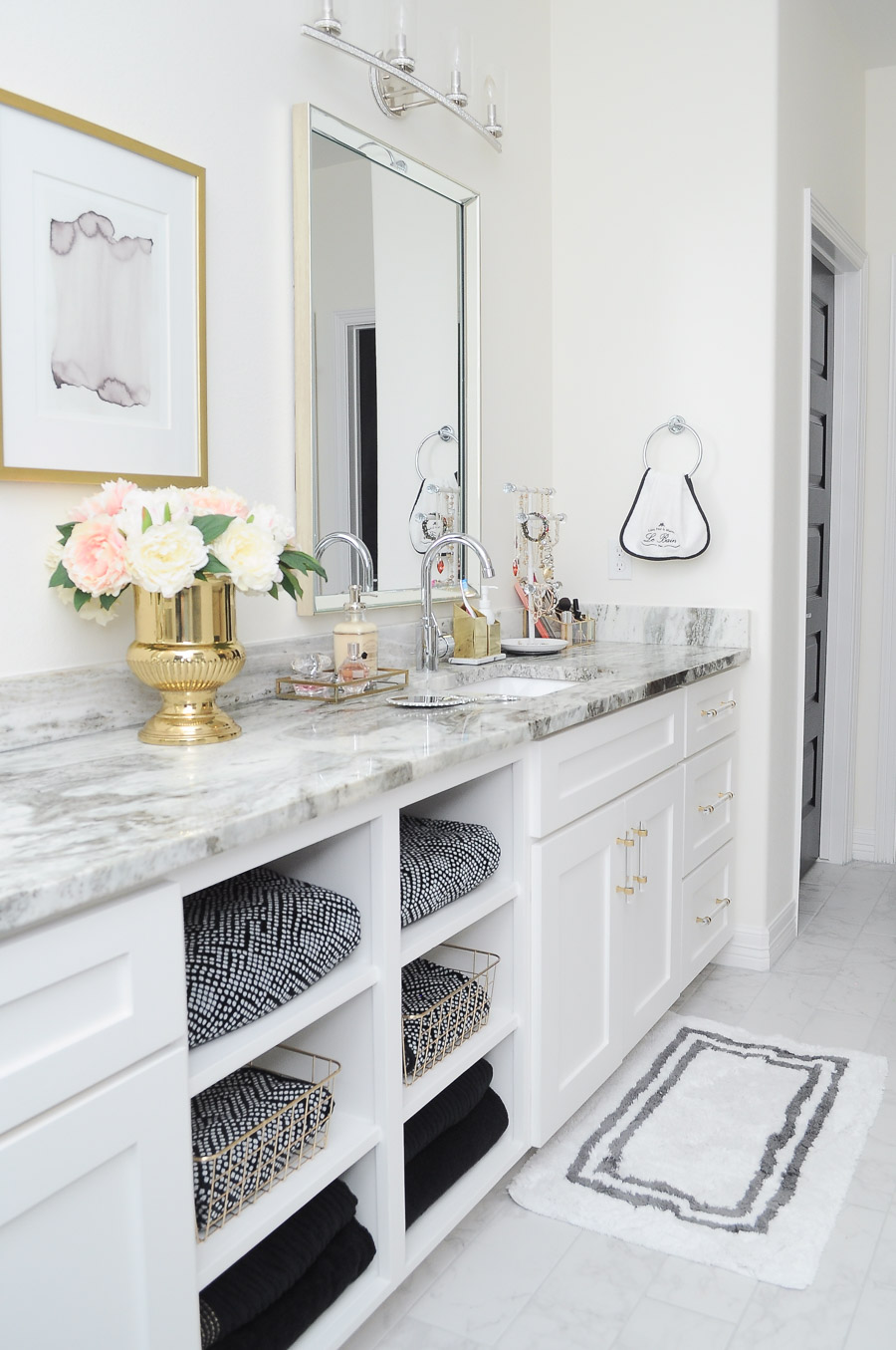 Master bathroom decor inspiration for a chic & glam bright white and gold boutique hotel look. Love the open shelving for the towels!