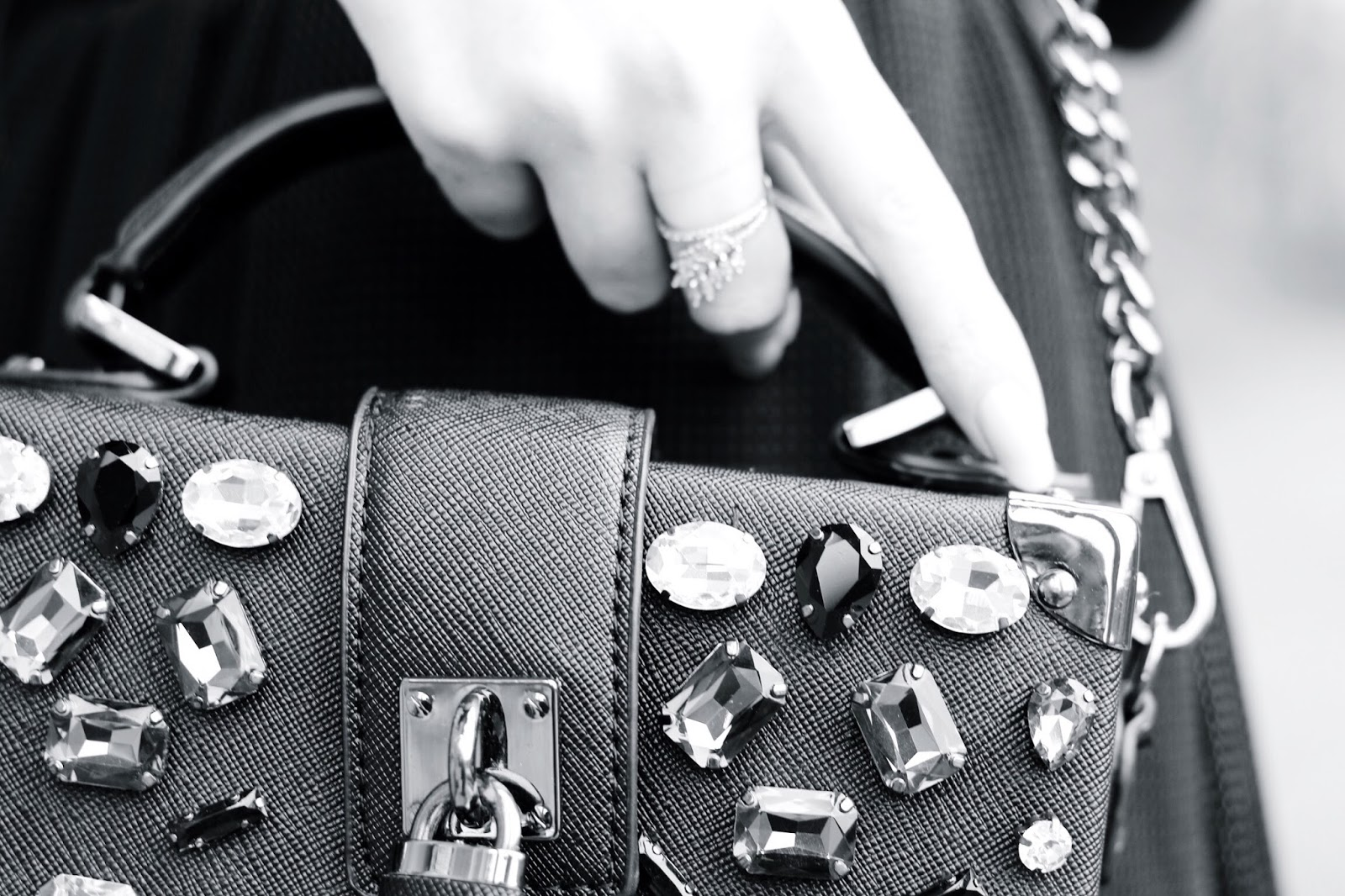 Close up detail shot embellished black handbag