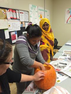 students carve pumpkins