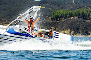 Campers and their Counselor gliding accross the water in their speed boat at Castaic Lake.