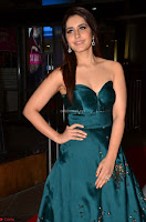 Raashi Khanna in Dark Green Sleeveless Strapless Deep neck Gown at 64th Jio Filmfare Awards South ~  Exclusive 002.JPG