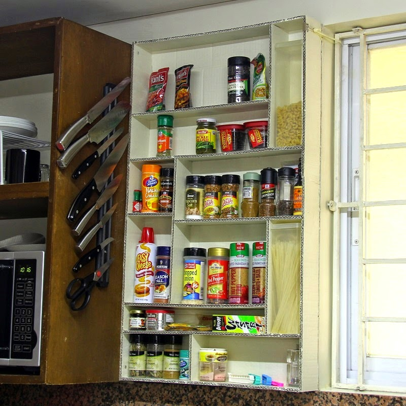 Mounted cardboard spice rack.