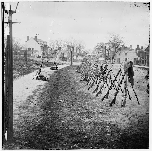 Row of stacked rifle muskets. Petersburg, Virginia in late 1864. Angel's Glow. marchmatron.com