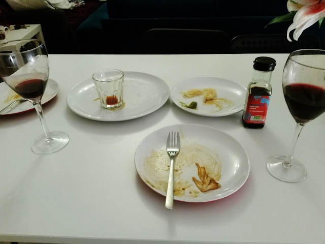 Empty dinner plates and wine glasses