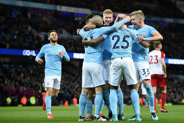 Manchester city players celebrate another stunning victory